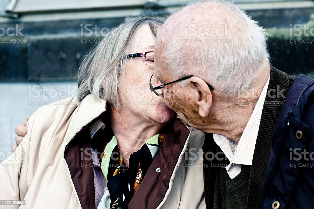 senior couple kissing and embracing royalty-free stock photo