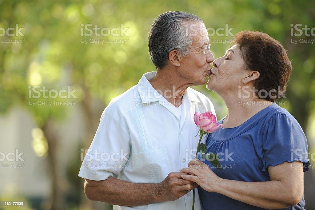 Senior couple kissing royalty-free stock photo