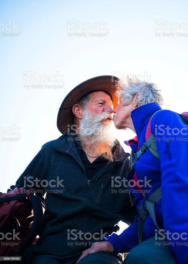 Senior Couple Kissing stock photo