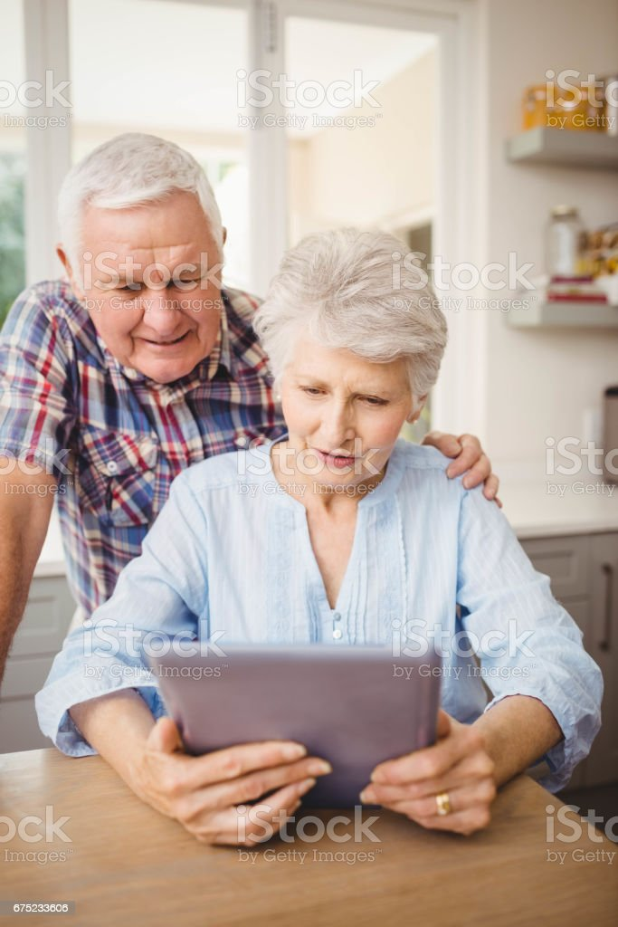 Senior couple looking at a digital tablet royalty-free stock photo