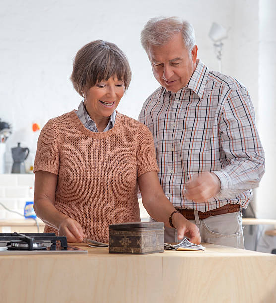 Senior Couple looking at Old Family photographs stock photo