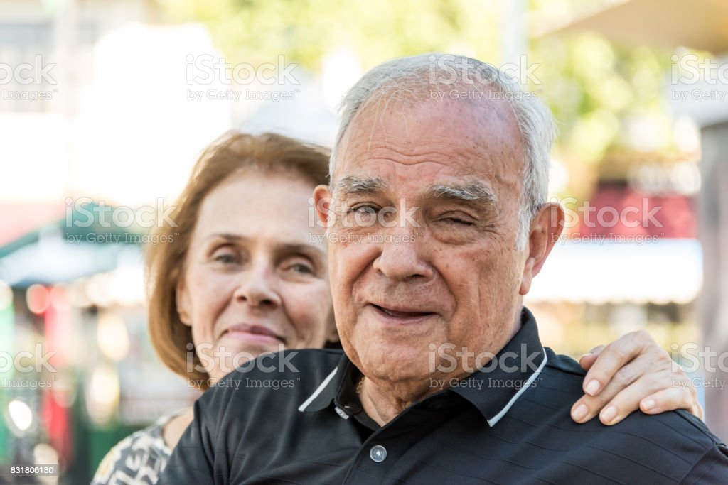 Senior couple looking at the camera stock photo