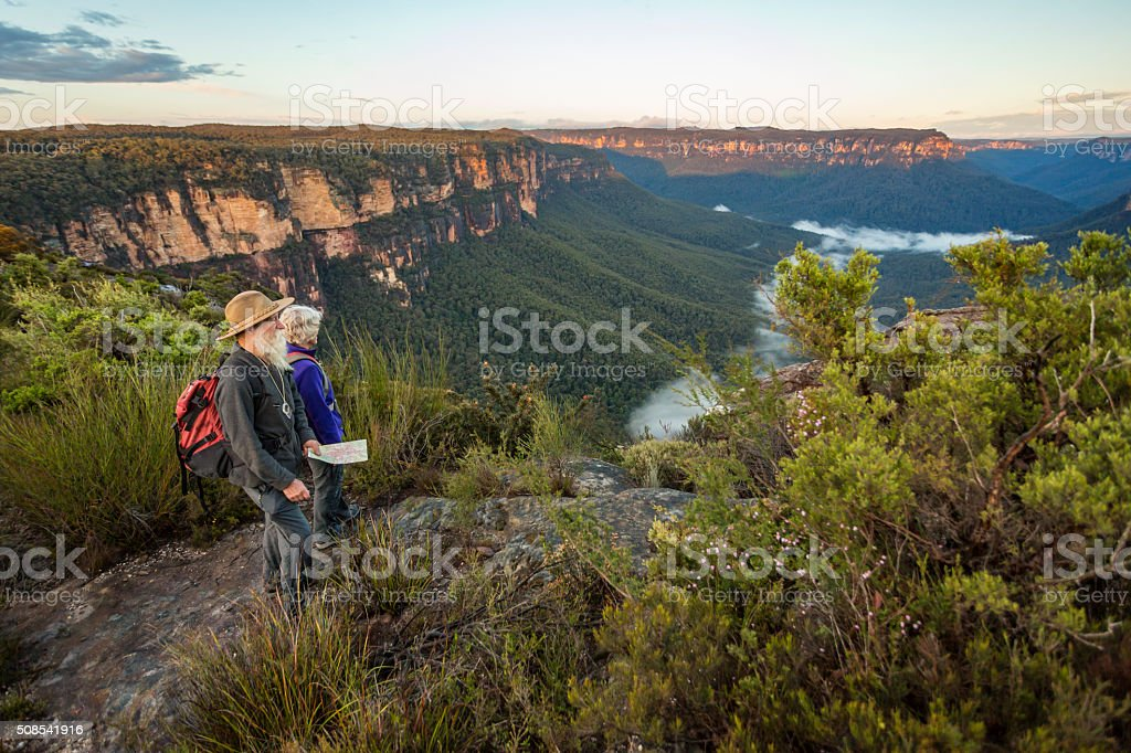 Senior Couple Looking at View While Bushwalking in Australia stock photo