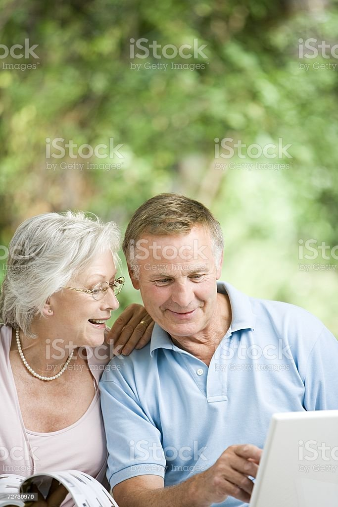 Senior couple looking on the internet royalty-free stock photo