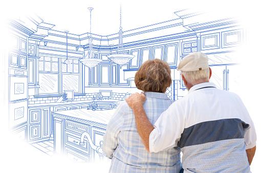 594910248 istock photo Senior Couple Looking Over Blue Custom Kitchen Design Drawing 467917074