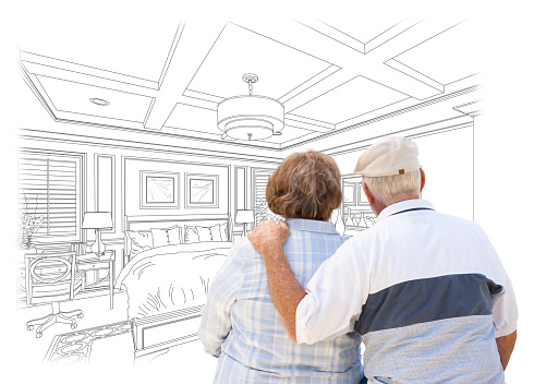 594910248 istock photo Senior Couple Looking Over Custom Bedroom Design Drawing 496825582