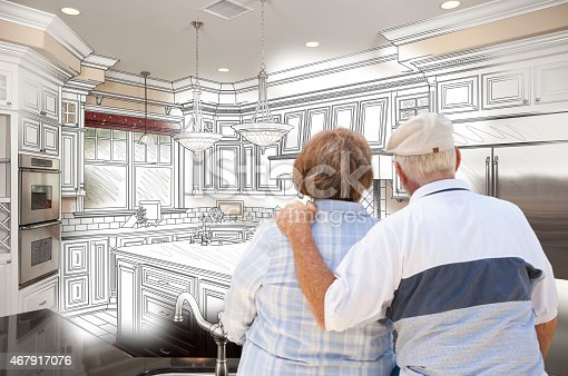 594910248istockphoto Senior Couple Looking Over Custom Kitchen Design Drawing and Pho 467917076