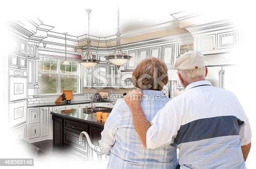 594910248istockphoto Senior Couple Looking Over Custom Kitchen Design Drawing and Pho 468369148