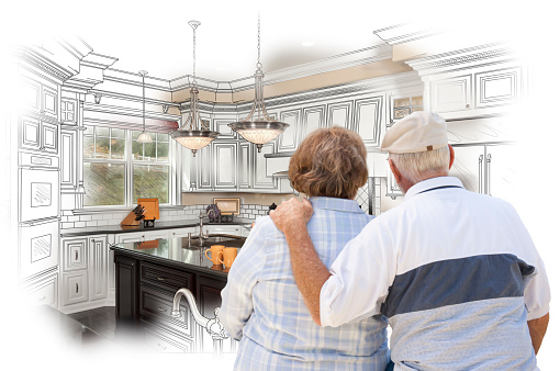 594910248 istock photo Senior Couple Looking Over Custom Kitchen Design Drawing and Pho 468369148