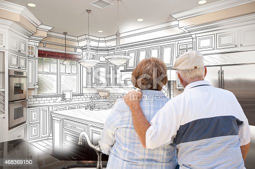 594910248istockphoto Senior Couple Looking Over Custom Kitchen Design Drawing and Pho 468369150