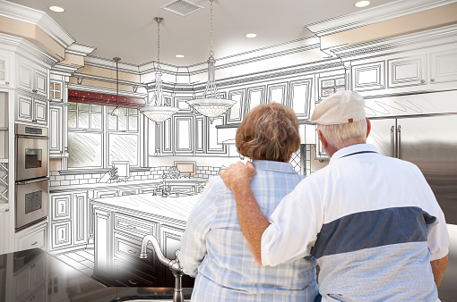 594910248 istock photo Senior Couple Looking Over Custom Kitchen Design Drawing and Pho 468369150