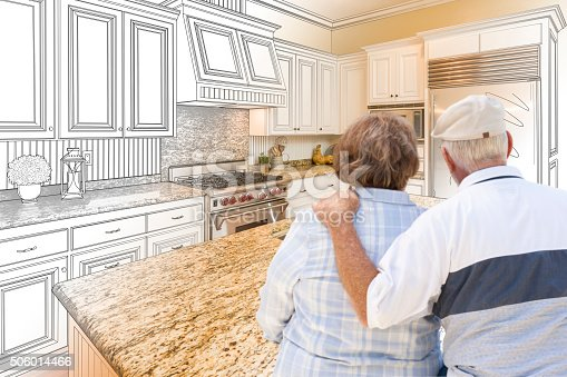 594910248istockphoto Senior Couple Looking Over Custom Kitchen Design Drawing and Photo 506014466