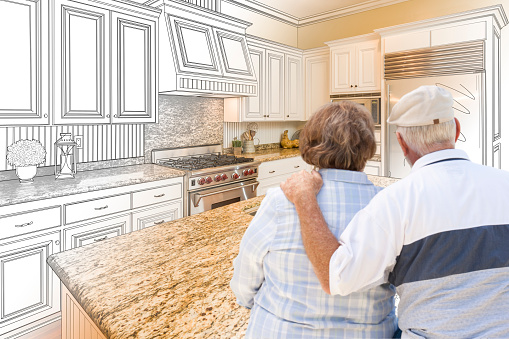 594910248 istock photo Senior Couple Looking Over Custom Kitchen Design Drawing and Photo 506014466