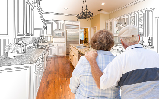 594910248 istock photo Senior Couple Looking Over Custom Kitchen Design Drawing and Photo 506014474