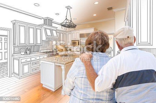 594910248istockphoto Senior Couple Looking Over Custom Kitchen Design Drawing 506014480