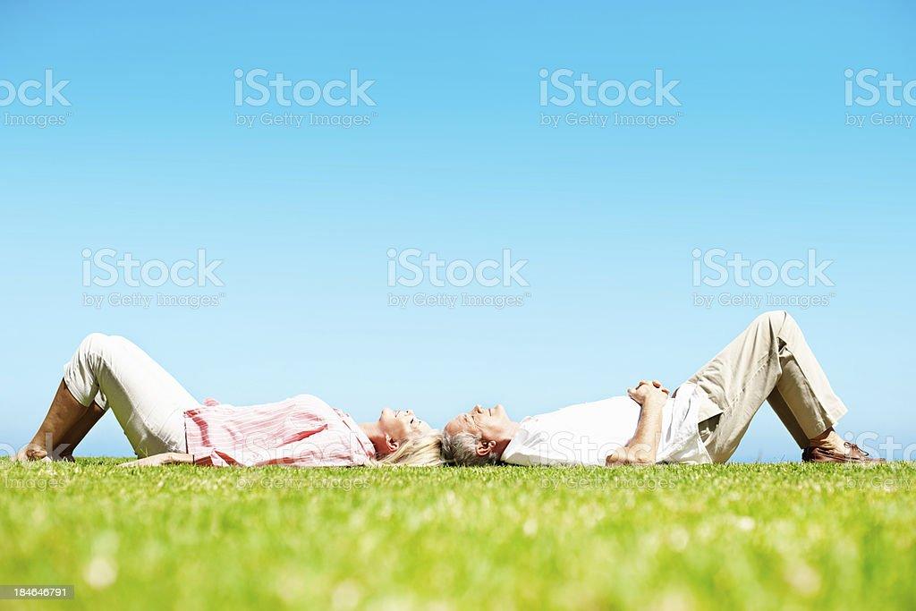 Senior couple lying together royalty-free stock photo