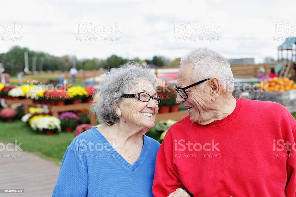 Senior Couple Man Woman Smiling Together at  Country Farm Market royalty-free stock photo