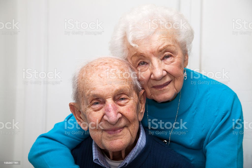 Senior couple married 69 years; focus on man stock photo