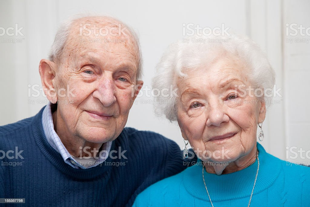 Senior couple married 69 years looking at the camera stock photo