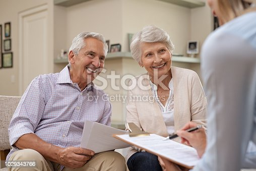 istock Senior couple meeting financial advisor 1029343766
