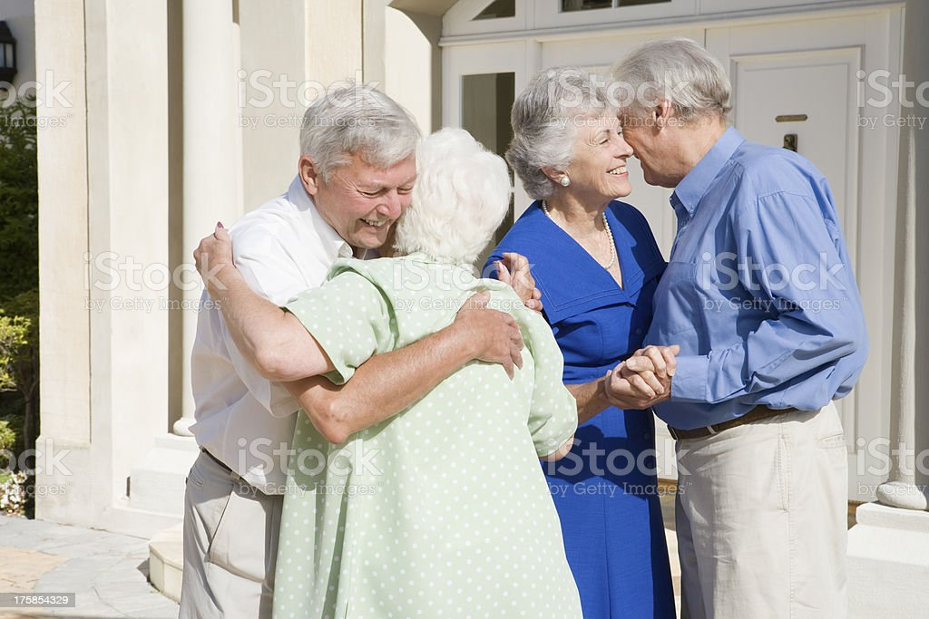 Senior couple meeting friends royalty-free stock photo