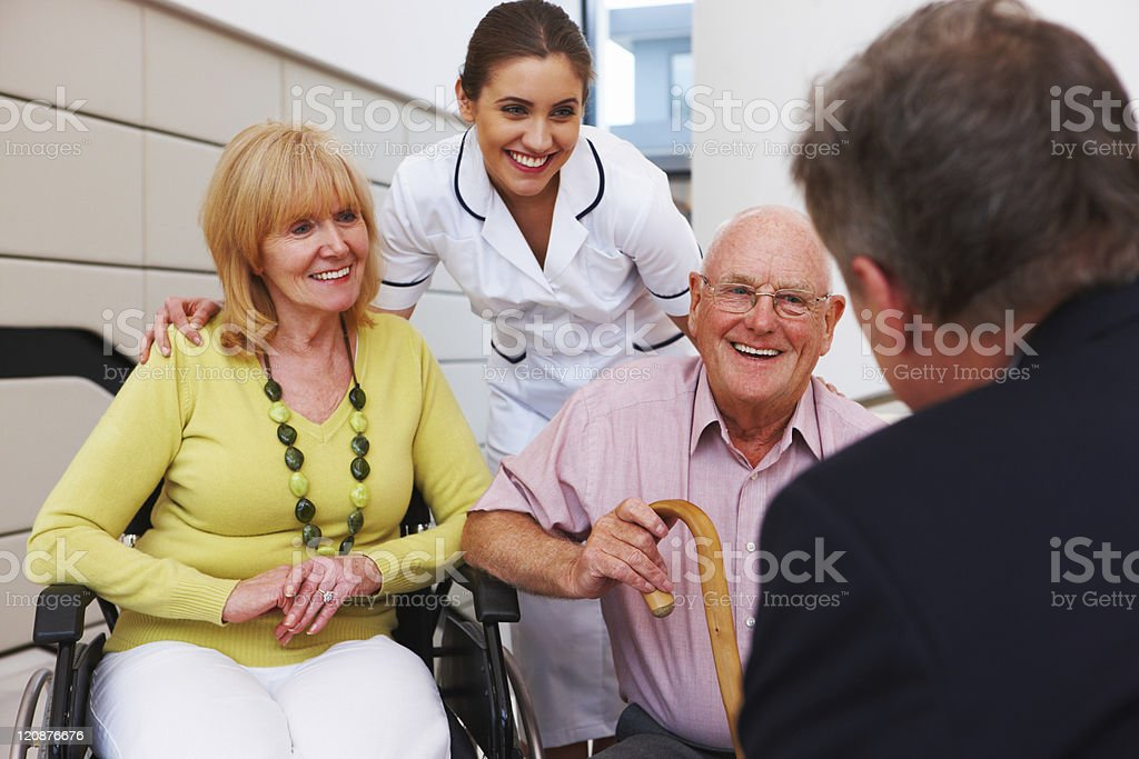 Senior Couple Meeting With a Doctor royalty-free stock photo