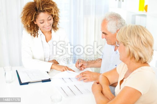 153136893 istock photo Senior Couple Meeting With Financial Advisor. 148317175