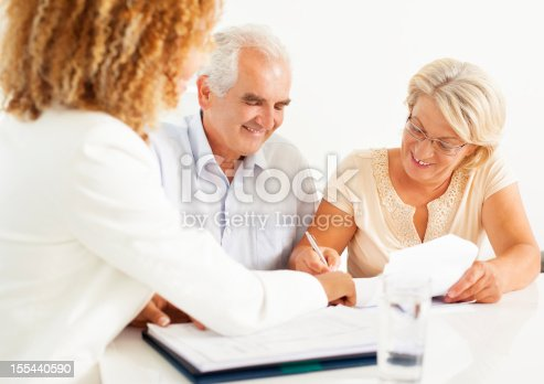 153136893 istock photo Senior Couple Meeting With Financial Advisor. 155440590
