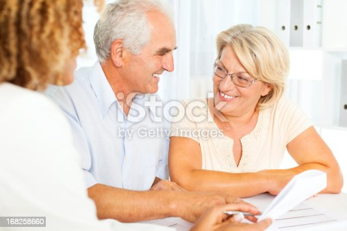 153136893 istock photo Senior Couple Meeting With Financial Advisor. 168258660