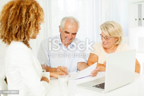 153136893 istock photo Senior Couple Meeting With Financial Advisor. 168518637