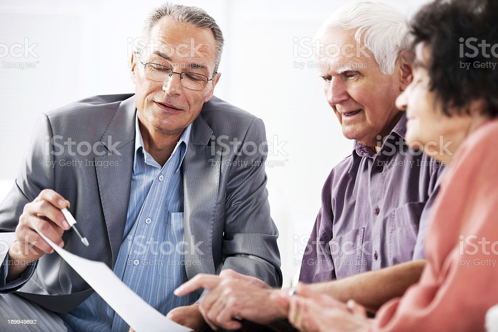 Senior couple meeting with financial advisor royalty-free stock photo