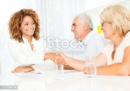 153136893 istock photo Senior Couple Meeting With Financial Advisor. 171299756
