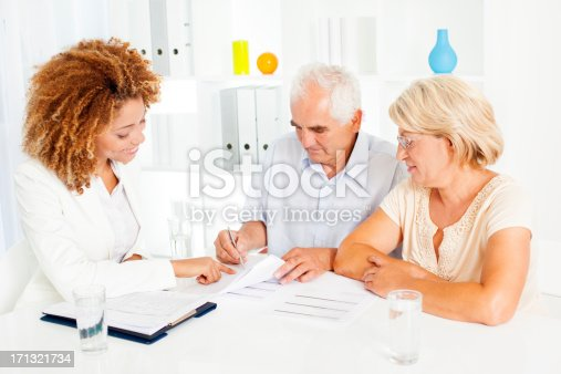 153136893 istock photo Senior Couple Meeting With Financial Advisor. 171321734