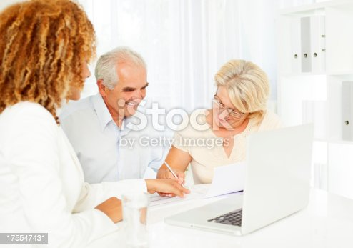 153136893 istock photo Senior Couple Meeting With Financial Advisor. 175547431