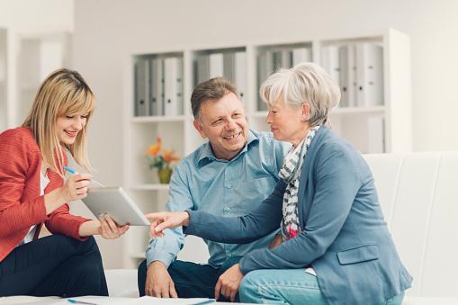 istock Senior Couple Meeting with Financial Advisor. 475559724