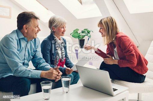 istock Senior Couple Meeting with Financial Advisor. 485026010