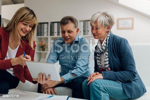 istock Senior Couple Meeting with Financial Advisor 509472718
