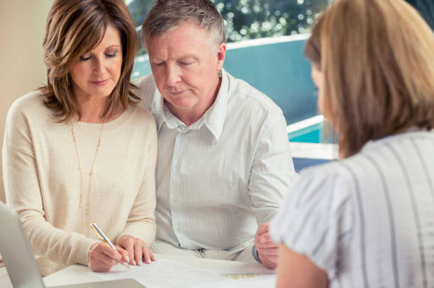 senior couple meeting with financial advisor. - will stock photos and pictures