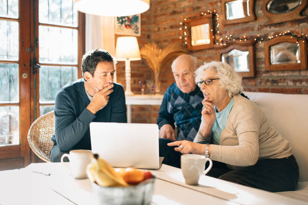 Senior couple meeting with real estate agent stock photo