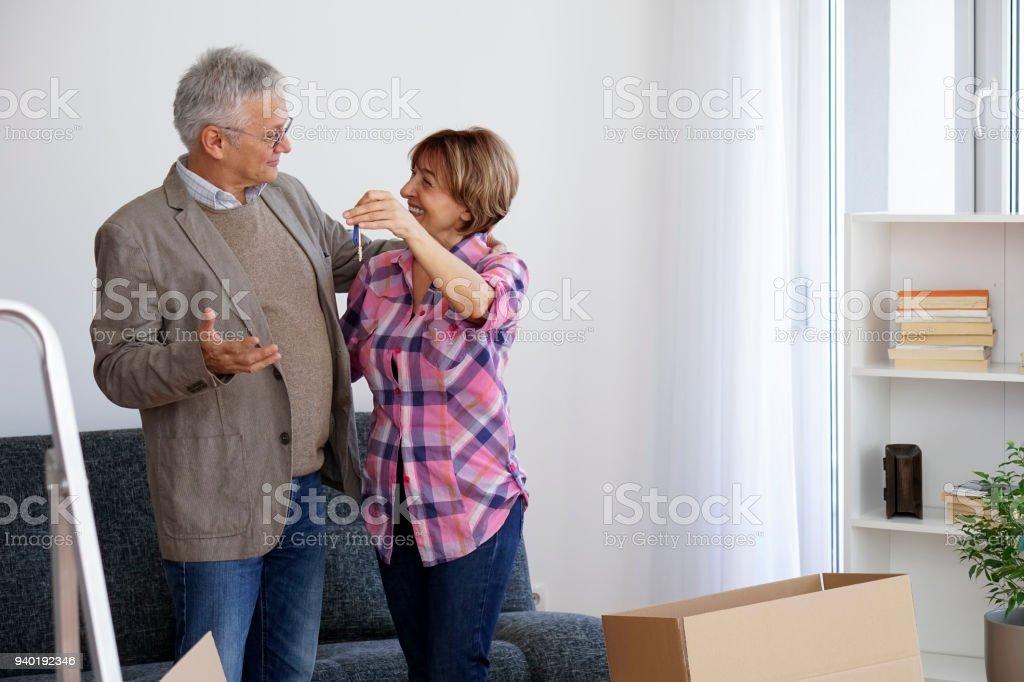 Senior couple moving into a new apartment stock photo