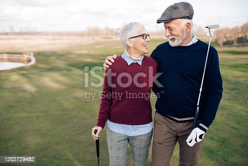 Senior couple going to play golf.