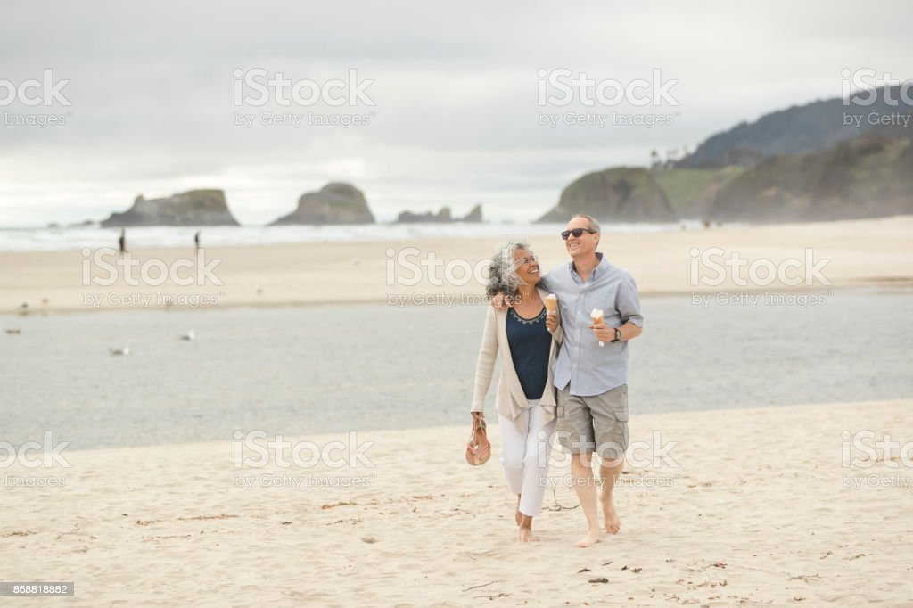 Senior couple on a date at the beach stock photo