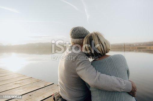 Photo of a senior couple on a lake dock