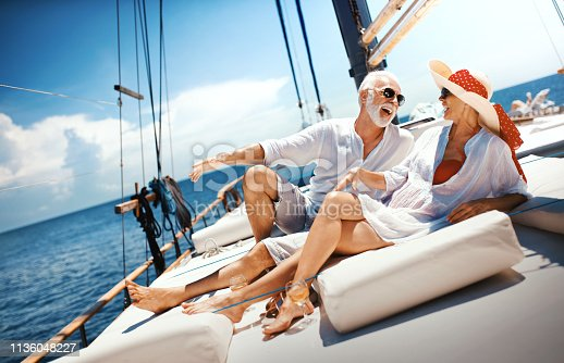 istock Senior couple on a sailing cruise. 1136048227