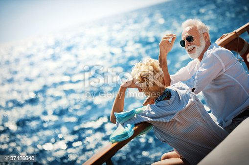 istock Senior couple on a sailing cruise. 1137426640
