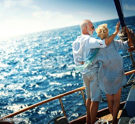 istock Senior couple on a sailing cruise. 1156247266
