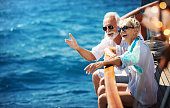 Senior couple on a sailing cruise.