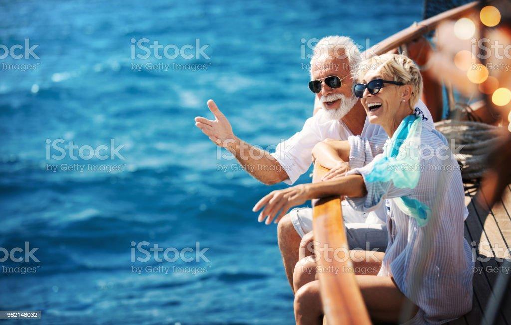 Senior couple on a sailing cruise. stock photo