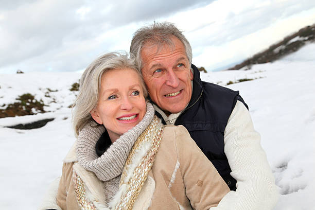 Senior couple on a snowy day stock photo