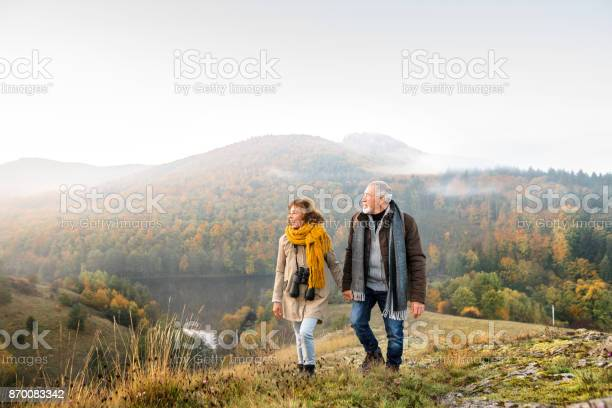 Senior couple on a walk in an autumn nature picture id870083342?b=1&k=6&m=870083342&s=612x612&h=eiljvzfai16dg9n7h4vhjqyaj3tmke5u2nl1 hiyuau=